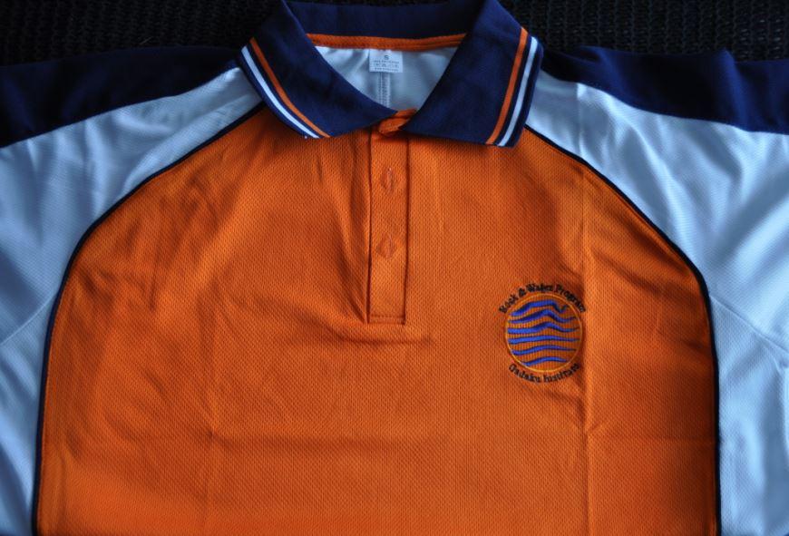 The orange Rock and Water facilitator shirt