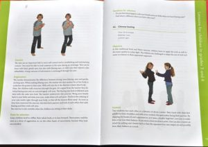 A page of the Primary manual showing the layout and colour pictures for each activity